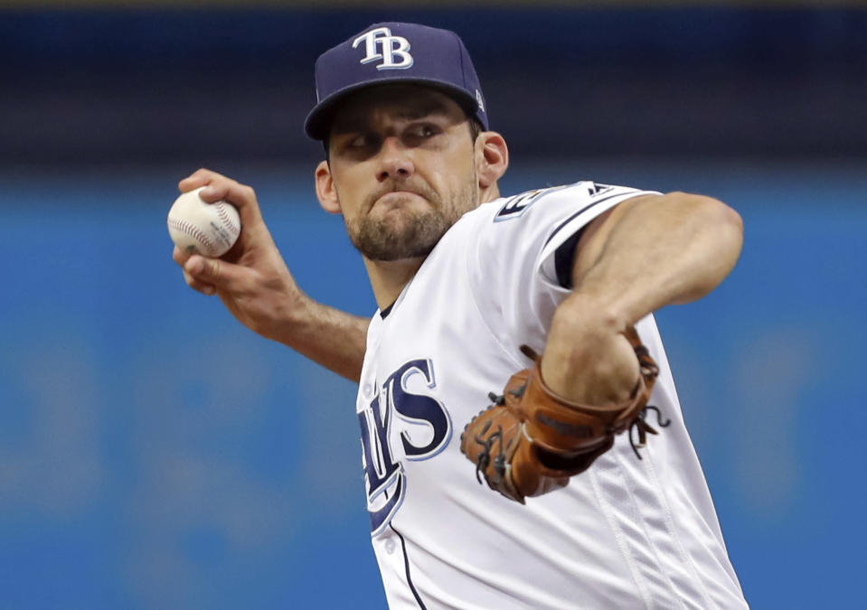 Tampa Bay Rays starting pitcher Nathan Eovaldi throws during the first inning of the team's baseball game against the Miami Marlins on Friday, July 20, 2018, in St. Petersburg, Fla. (AP Photo/Mike Carlson)