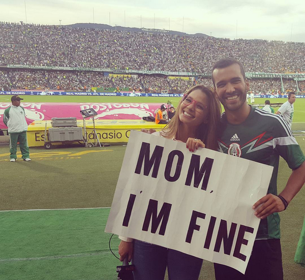 Mugging for the camera alongside TV personality Melissa Martinez at a football game in Medellin.