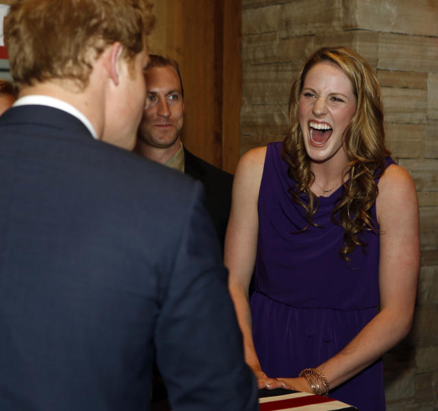 Olympic gold medalist Missy Franklin laughs as she talks with Britain's Prince Harry at a reception at the Sanctuary Golf Course in Sedalia, Colo., south of Denver on Friday, May 10, 2013. (AP Photo/Ed Andrieski, Pool)