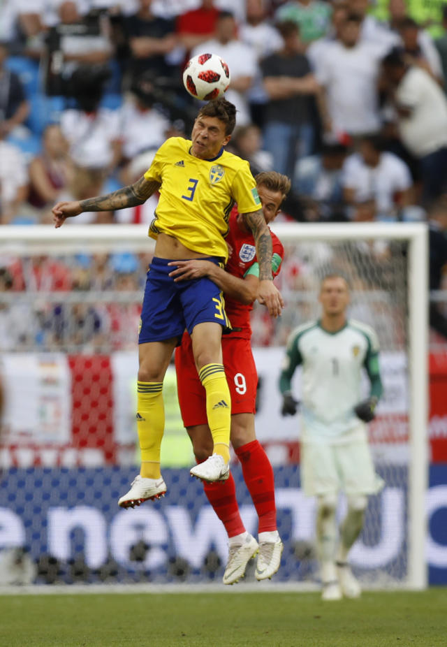 <p>Sweden's Victor Lindelof jumps for the ball with England's Harry Kane </p>