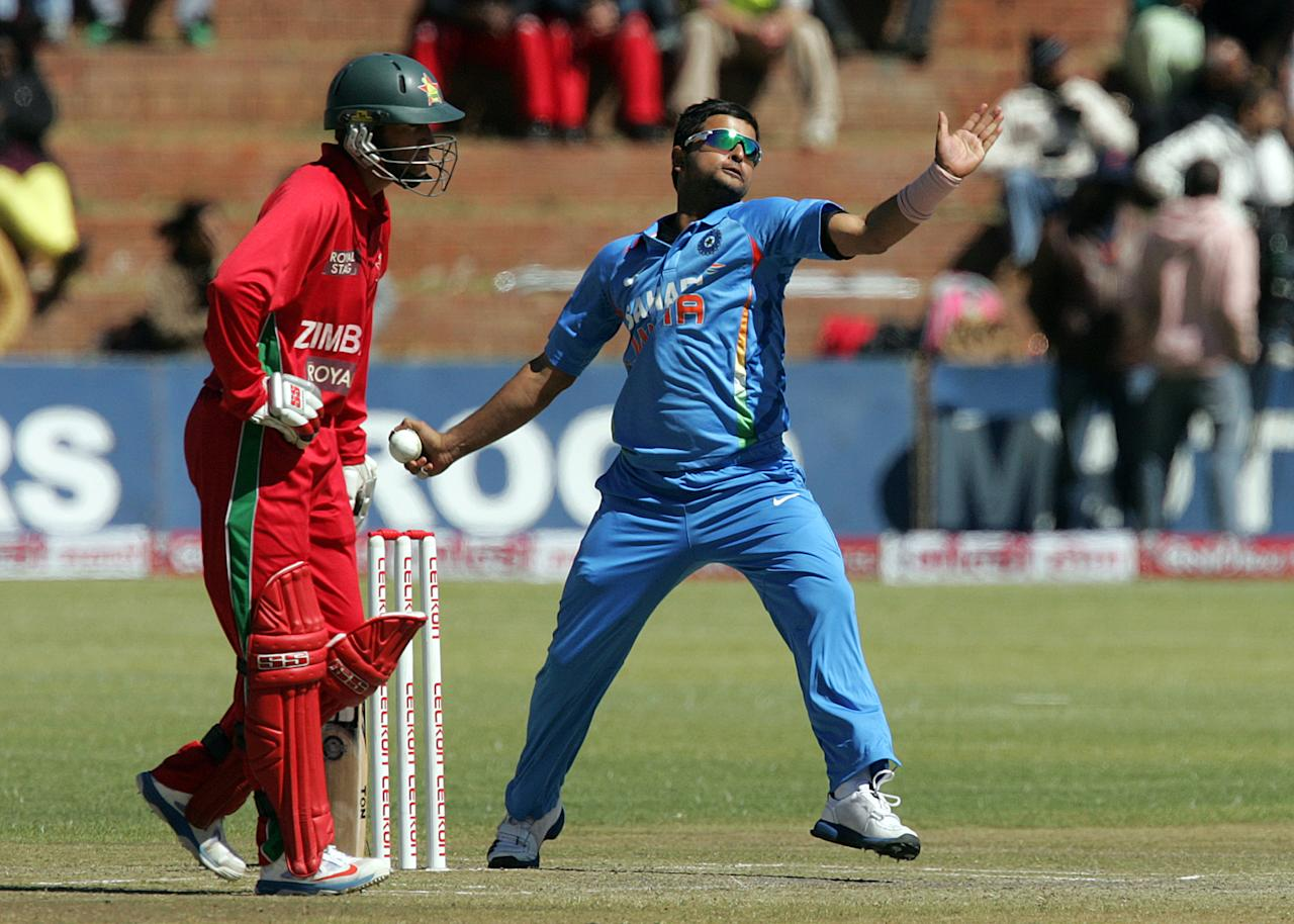 Indian bowler Suresh Raina in action during the 5th and final game of the cricket ODI series between hosts Zimbabwe and India at Queens Sports Club on August 3, 2013 in Bulawayo. AFP/PHOTO Jekesai Njikizana.        (Photo credit should read JEKESAI NJIKIZANA/AFP/Getty Images)