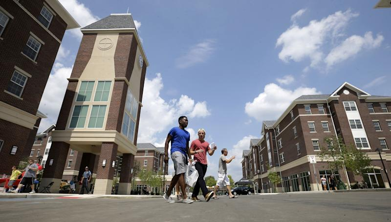 People walk through Campus Town at The College of New
