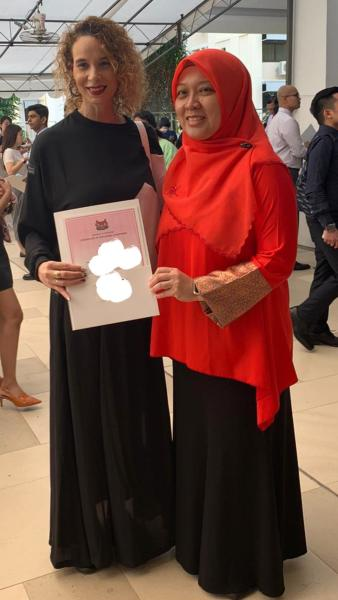 Wendy Jacobs, formerly South African wife of Singaporean football star Fandi Ahmad, received her certificate of citizenship from MP Intan Azura Mokhtar on 12 January 2020. (PHOTO: Intan Mokhtar/Facebook)