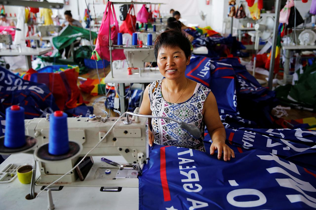 "<p>A worker poses for pictures as she makes flags for U.S. President Donald Trump's ""Keep America Great!"" 2020 re-election campaign at Jiahao flag factory in Fuyang, Anhui province, China July 24, 2018. (Photo: Aly Song/Reuters) </p>"