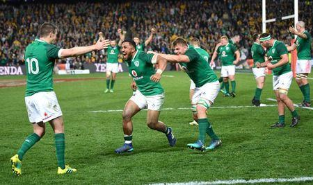 Rugby Union - June Internationals - Australia vs Ireland - Sydney Football Stadium, Sydney, Australia - June 23, 2018 - Johnny Sexton of Ireland celebrates with team mates Bundee Aki and Jordi Murphy after winning the game. AAP/David Moir/via REUTERS