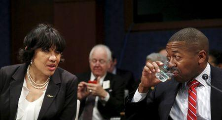 Flint, Michigan Mayor Karen Weaver (L) talks with Flint School District Superintendent Bilal Kareem Tawwab (R) before testifying at the House Democratic Steering and Policy Committee on the Flint lead water crisis in Washington February 10, 2016.  REUTERS/Gary Cameron