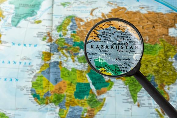 A map with Kazakhstan highlighted with a magnifying glass