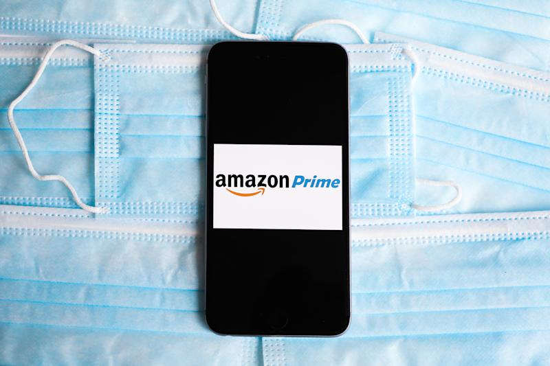 Amazon Prime logo is displayed on a mobile phone screen photographed on surgical masks background for illustration photo during the spread of coronavirus. Krakow, Poland on April 26, 2020. (Photo Illustration by Beata Zawrzel/NurPhoto via Getty Images)