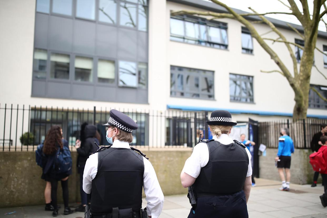 Police officers outside Pimlico Academy School, west London, where students have staged a walkout in protest over a school uniform policy that they claim is discriminatory and racist. Picture date: Wednesday March 31, 2021. (Photo by Aaron Chown/PA Images via Getty Images)