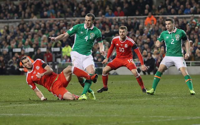 <span>Gareth Bale was lucky to stay on the pitch for this tackle on John O'Shea</span> <span>Credit: rex </span>