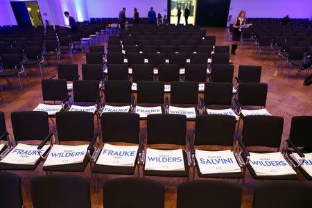 Chairs are prepared with placards with the names of Germany's Alternative for Germany (AfD) leader Frauke Petry, Matteo Salvini of the Northern League and Netherlands' Party for Freedom (PVV) leader Geert Wilders before the start of a European far-right leaders meeting to discuss about the European Union, in Koblenz, Germany, January 21, 2017.    REUTERS/Wolfgang Rattay