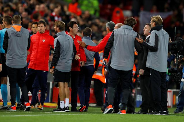 Soccer Football – Champions League – Liverpool vs Sevilla – Anfield, Liverpool, Britain – September 13, 2017 Sevilla coach Eduardo Berizzo tries to talk to Liverpool manager Juergen Klopp at the end of the match REUTERS/Phil Noble