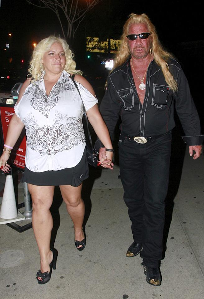 Duane 'Dog' Chapman's uniform (complete with barely-buttoned shirt and steel-toe boots) rarely wavers. However, his bride, Beth, likes to mix it up from time to time. On Wednesday night, the bounty huntress was spotted leaving dinner in L.A. with her man in a cold-shoulder, bandana-like blouse, Nike tennis skirt, and bow-adorned peep-toes. Classy! (3/27/2013)