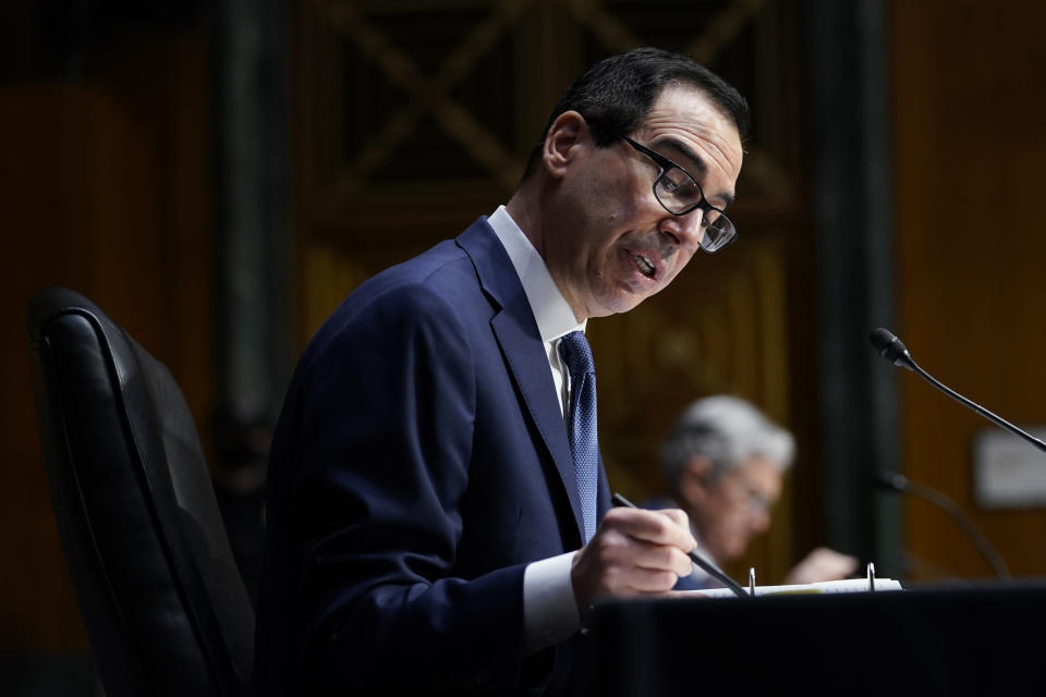 Treasury Secretary Steven Mnuchin testifies during a Senate Banking Committee hearing on 'The Quarterly CARES Act Report to Congress' on Capitol Hill in Washington, Tuesday, Dec. 1, 2020. (AP Photo/Susan Walsh, Pool)