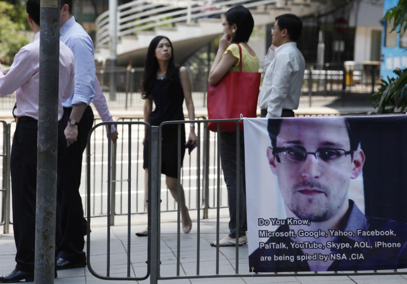 A banner supporting Edward Snowden, a former CIA employee who leaked top-secret documents about sweeping U.S. surveillance programs, is displayed at Central, Hong Kong's business district, Wednesday, June 19, 2013. U.S. President Barack Obama defended top secret National Security Agency spying programs as legal in a lengthy interview, and called them transparent - even though they are authorized in secret. (AP Photo/Kin Cheung)