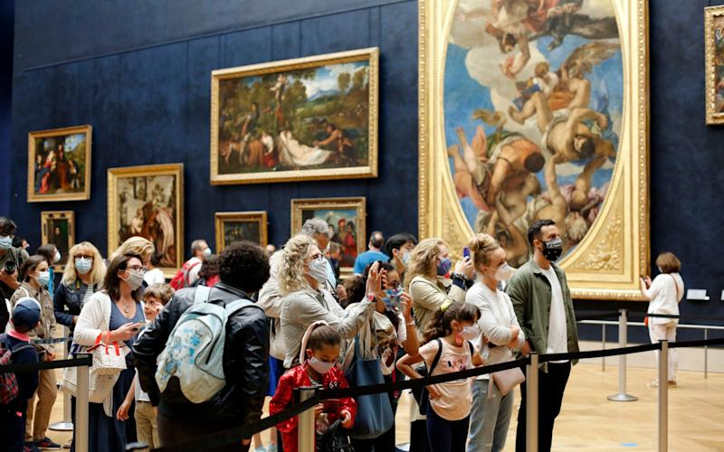 The Louvre has reopened today for the first time in four months - AP