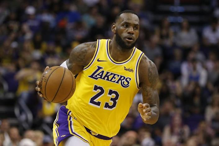 Los Angeles Lakers forward LeBron James controls the ball in the second half against the Phoenix Suns in Phoenix on March 2.