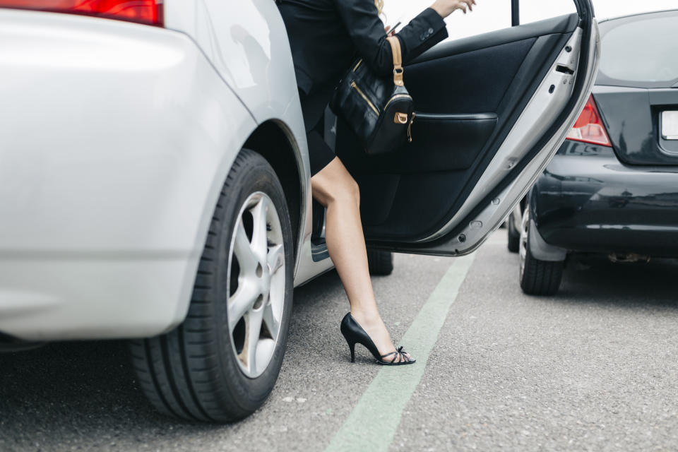 Woman getting out of car. Source: Getty Images