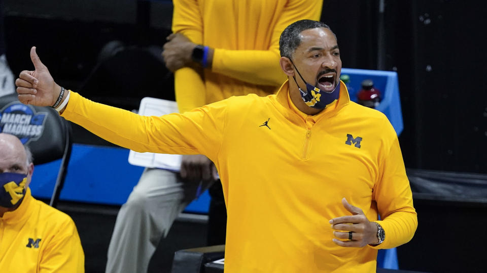 Michigan head coach Juwan Howard directs his team during the first half of an Elite 8 game against UCLA in the NCAA men's college basketball tournament at Lucas Oil Stadium, Tuesday, March 30, 2021, in Indianapolis. (AP Photo/Darron Cummings)