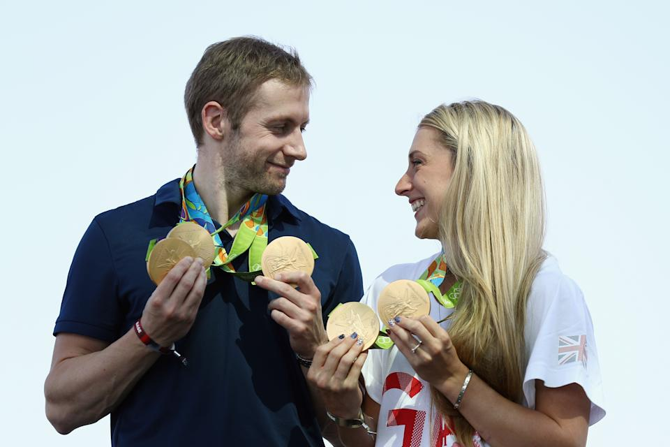 RIO DE JANEIRO, BRAZIL - AUGUST 17:  Team GB cyclists Laura Trott and Jason Kenny pose with their gold medals at Adidas House on August 17, 2016 in Rio de Janeiro, Brazil.  (Photo by Bryn Lennon/Getty Images)