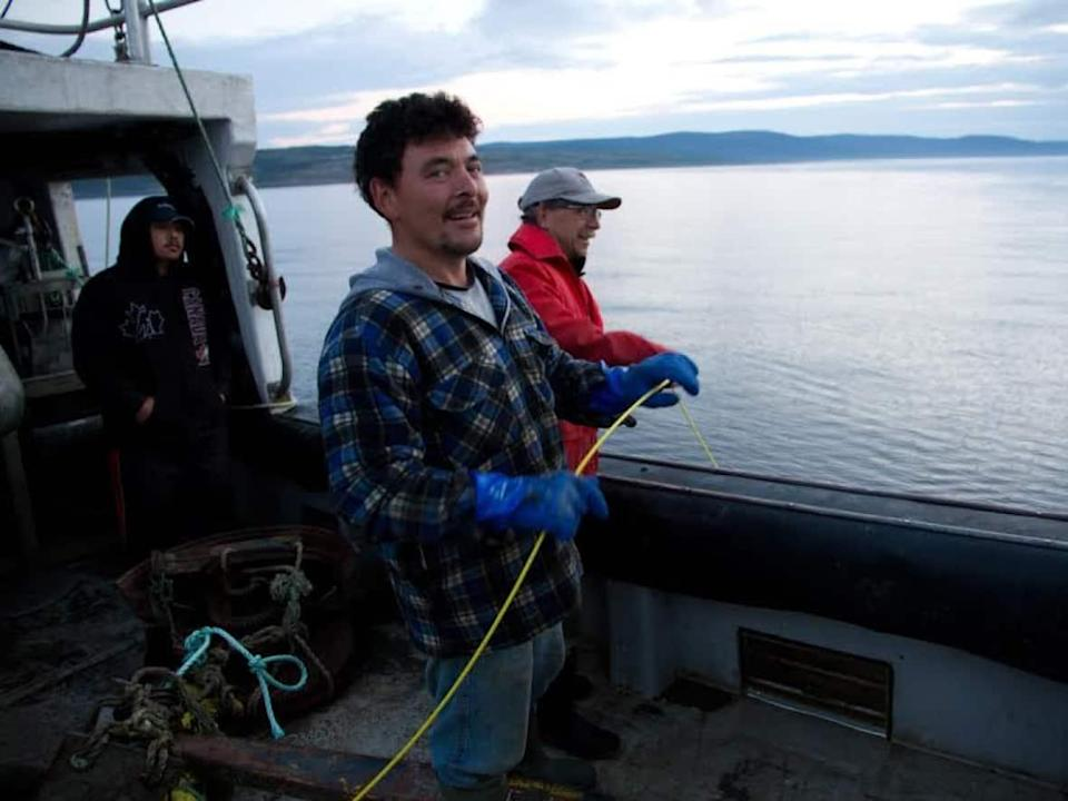 Joey Angnatok, centre, pulled up his nets a few years ago from an underwater mound to find corals, sponges and other sea life. (Rodd Laing - image credit)