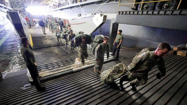 PHOTO: The Army's 602nd Area Support Medical Company boards the U.S.S. Kearsarge aircraft carrier from a Navy landing craft during their evacuation from the U.S. Virgin Islands in advance of Hurricane Maria, Sept. 17, 2017. (Jonathan Drake/Reuters)