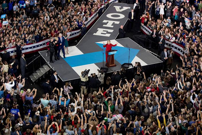 <p>Democratic presidential candidate Hillary Clinton, accompanied by former President Bill Clinton, Chelsea Clinton, and musicians Jon Bon Jovi and Lady Gaga, speaks at a midnight rally at Reynolds Coliseum at North Carolina State University in Raleigh, N.C., Tuesday, Nov. 8, 2016. (Photo: Andrew Harnik/AP) </p>