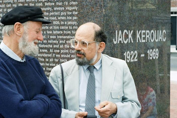 Lawrence Ferlinghetti (left) and Allen Ginsberg talk during the dedication of the Jack Kerouac Commemorative, a work of public art in Lowell, Mass., on June 25, 1988.