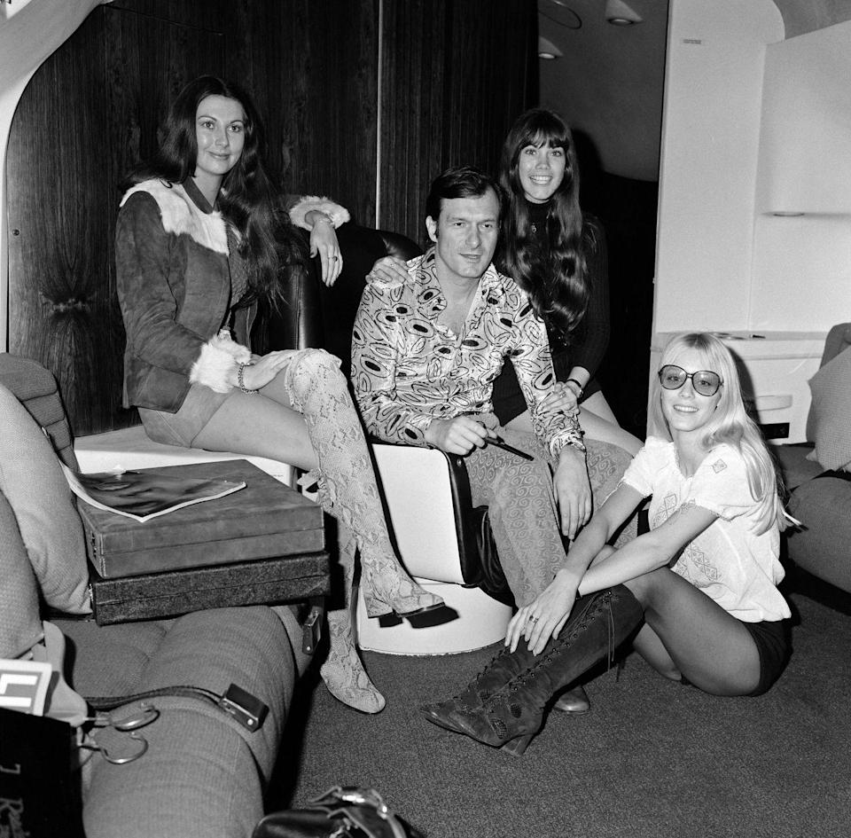 <p>Hugh Hefner aboard the Playboy Jet in 1971. </p>
