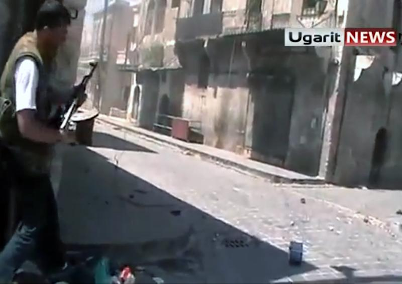 In this frame grab made from amateur video provided by Ugarit News, taken on Sunday, Aug. 26, 2012, purports to show a member of the rebel group, the Unification Brigade, as he prepares to fire his weapon at a group of Assad soldiers in street fighting in Aleppo, Syria. (AP Photo/Ugarit News via AP video) THE ASSOCIATED PRESS IS UNABLE TO INDEPENDENTLY VERIFY THE AUTHENTICITY, CONTENT, LOCATION OR DATE OF THIS CITIZEN JOURNALIST IMAGE