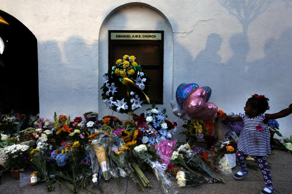 FILE - In this June 18, 2015, file photo, mourners pass by a makeshift memorial on the sidewalk in front of the Mother Emanuel AME Church following the shooting of nine Black parishioners in Charleston, S.C. (AP Photo/Stephen B. Morton, File)