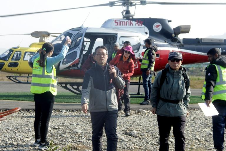 Helicopters were sent out on Saturday to rescue about 200 people stranded around Annapurna and other nearby mountains after the avalanche (AFP Photo/KRISHNA MANI BARAL)