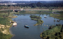 "<p>These retro-futuristic boats hold the dubious distinction of being the first ride ever removed from Disneyland due to <a href=""http://www.disneyhistoryinstitute.com/2011/09/phantom-boats.html"" rel=""nofollow noopener"" target=""_blank"" data-ylk=""slk:repeated mechanical problems"" class=""link rapid-noclick-resp"">repeated mechanical problems</a>. The 2-3 seater fiberglass flotation vehicles — which zipped around the Tomorrowland Lagoon — were removed in 1956, just a year after the park opened. <i>(Photo: Disneyhistoryinstitue.com)</i></p>"