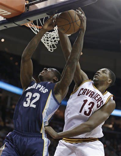 Memphis Grizzlies' Ed Davis (32) is stopped by Cleveland Cavaliers' Tristan Thompson (13) during the second quarter of an NBA basketball game Friday, March 8, 2013, in Cleveland. (AP Photo/Tony Dejak)