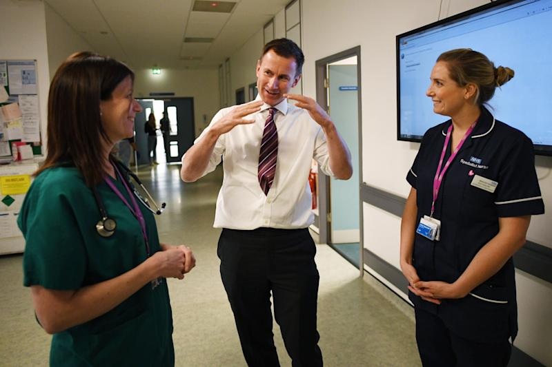 Jeremy Hunt talks to staff at St George's Hospital, Tooting. (PA Wire/PA Images)