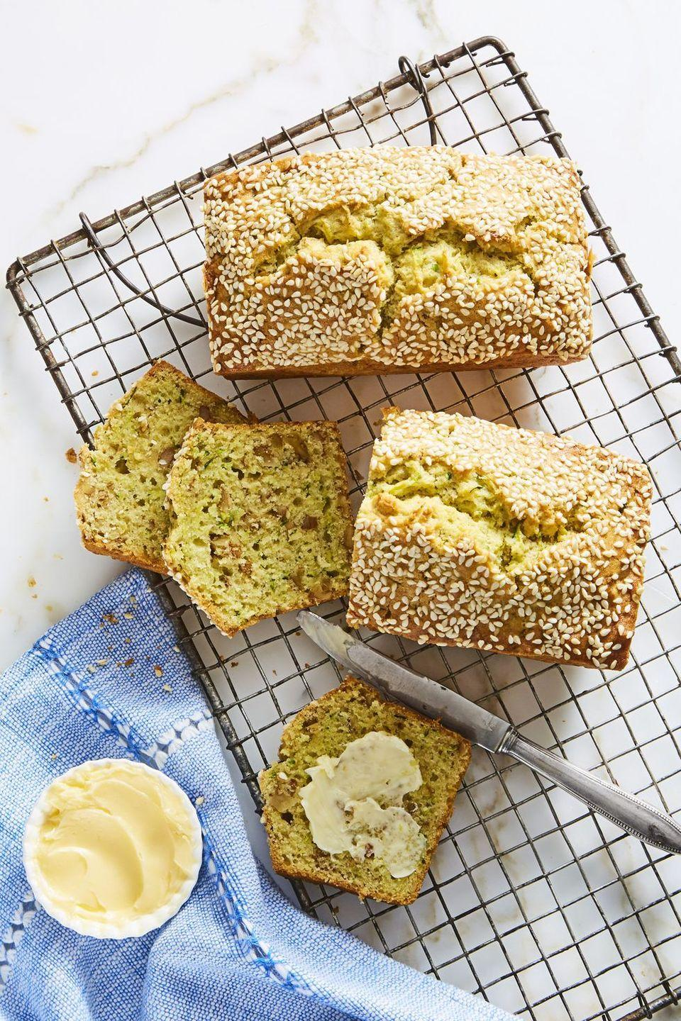 """<p>Make 'em mini so dad gets his own loaf. Don't forget the butter!</p><p><em><a href=""""https://www.goodhousekeeping.com/food-recipes/easy/a22576509/mini-sesame-zucchini-loaves-recipe/"""" rel=""""nofollow noopener"""" target=""""_blank"""" data-ylk=""""slk:Get the recipe for Mini Sesame Zucchini Loaves »"""" class=""""link rapid-noclick-resp"""">Get the recipe for Mini Sesame Zucchini Loaves »</a></em></p>"""