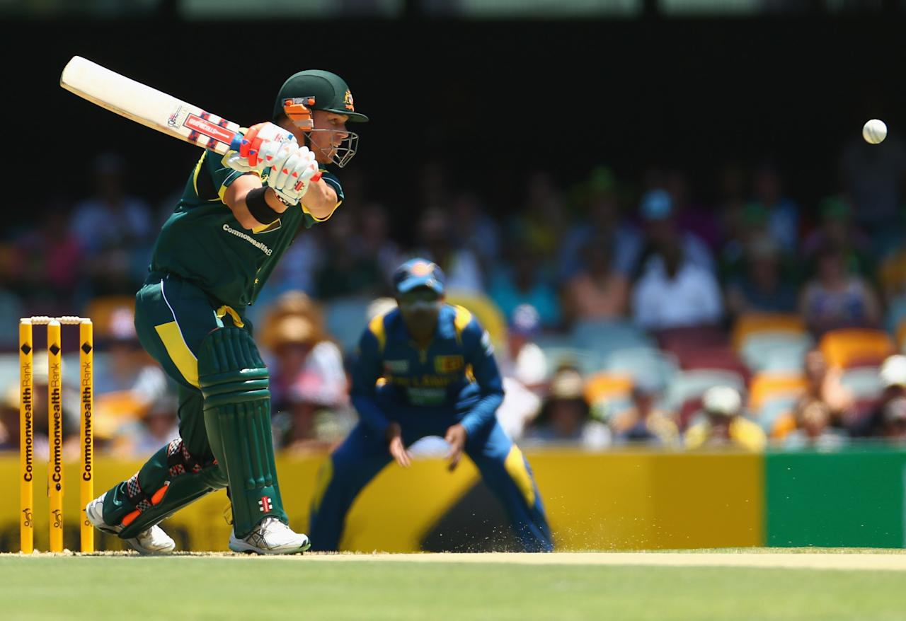 BRISBANE, AUSTRALIA - JANUARY 18: David Warner of Australia bats during game three of the Commonwealth Bank One Day International Series between Australia and Sri Lanka at The Gabba on January 18, 2013 in Brisbane, Australia.  (Photo by Robert Cianflone/Getty Images)