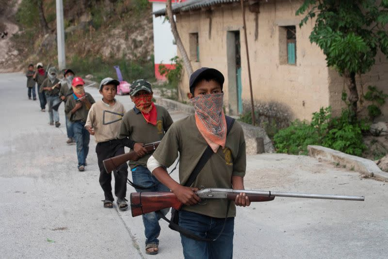 "The Wider Image: ""Under siege"": Inside Mexican village where children are armed"