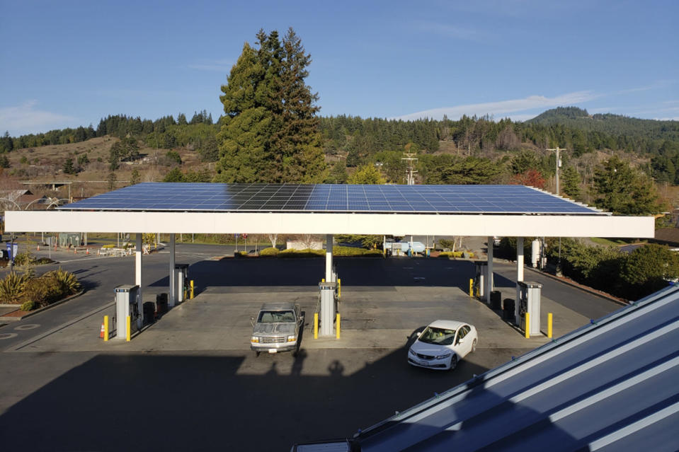 This photo provided by the Blue Lake Rancheria shows a solar array on top of a fuel island canopy that is paired with a microgrid in Blue Lake, Calif., in 2019. A Native American reservation on California's far northern coast kept the electricity flowing with the help of two microgrids that can disconnect from the larger electrical grid and switch to using solar energy generated and stored in battery banks near its hotel-casino. As most of rural Humboldt County sat in the dark during a planned shutoff in October 2019, the Blue Lake Rancheria became a lifeline for thousands of its neighbors. (Blue Lake Rancheria via AP)