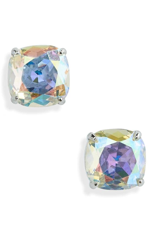 """<p>How cool are these irrdscent <a href=""""https://www.popsugar.com/buy/Kate-Spade-New-York-Mini-Small-Square-Semiprecious-Stone-Stud-Earrings-526562?p_name=Kate%20Spade%20New%20York%20Mini%20Small%20Square%20Semiprecious%20Stone%20Stud%20Earrings&retailer=shop.nordstrom.com&pid=526562&price=23&evar1=fab%3Aus&evar9=42665016&evar98=https%3A%2F%2Fwww.popsugar.com%2Ffashion%2Fphoto-gallery%2F42665016%2Fimage%2F46973267%2FKate-Spade-New-York-Mini-Small-Square-Semiprecious-Stone-Stud-Earrings&list1=shopping%2Cjewelry%2Choliday%2Cgift%20guide%2Choliday%20fashion%2Cfashion%20gifts%2Cgifts%20for%20women%2Cgifts%20under%20%24100&prop13=mobile&pdata=1"""" rel=""""nofollow"""" data-shoppable-link=""""1"""" target=""""_blank"""" class=""""ga-track"""" data-ga-category=""""Related"""" data-ga-label=""""https://shop.nordstrom.com/s/kate-spade-new-york-mini-small-square-semiprecious-stone-stud-earrings/3397197/full?origin=category-personalizedsort&amp;breadcrumb=Home%2FWomen%2FJewelry&amp;color=crystal%20ab%2F%20silver"""" data-ga-action=""""In-Line Links"""">Kate Spade New York Mini Small Square Semiprecious Stone Stud Earrings</a> ($23, originally $28)?</p>"""