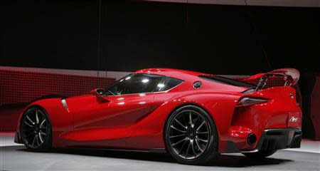The Toyota FT-1 concept car is unveiled on stage during the press preview day of the North American International Auto Show in Detroit, Michigan January 13, 2014. REUTERS/Rebecca Cook