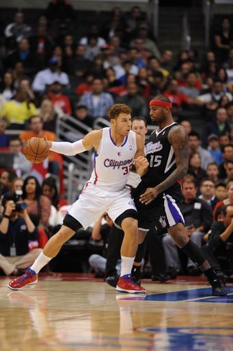 LOS ANGELES, CA - DECEMBER 1: Blake Griffin #32 of the Los Angeles Clippers protects the ball from DeMarcus Cousins #15 of the Sacramento Kings during the game between the Los Angeles Clippers and the Sacramento Kings at Staples Center on December 1, 2012 in Los Angeles, California. (Photo by Noah Graham/NBAE via Getty Images)