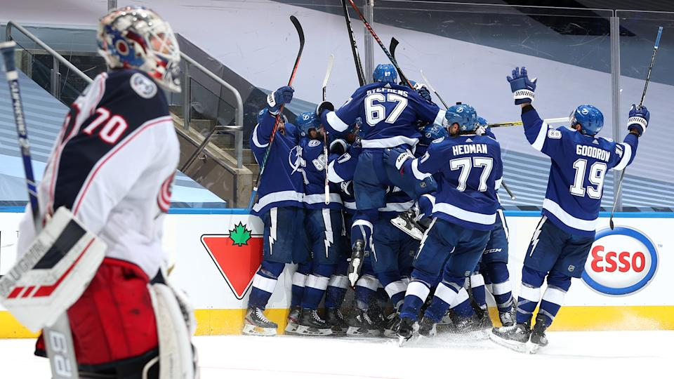 TORONTO, ONTARIO - AUGUST 11: The Tampa Bay Lightning celebrate after Brayden Point #21 scored the game winning goal at 10:27 in the fifth overtime to win 3-2 over the Columbus Blue Jackets after Game One of the Eastern Conference First Round of the 2020 NHL Stanley Cup Playoff at Scotiabank Arena on August 11, 2020 in Toronto, Ontario. (Photo by Chase Agnello-Dean/NHLI via Getty Images)