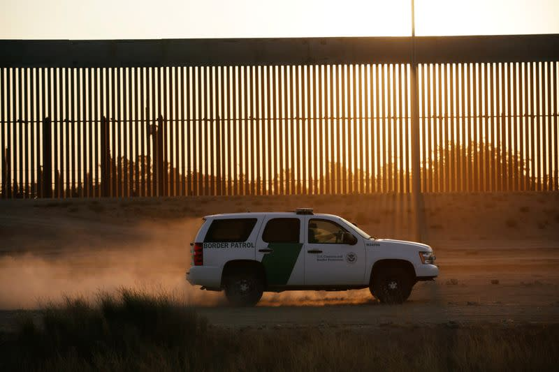 A vehicle of U.S. Customs and Border Protection (CBP) patrols along a new section of the border wall in El Paso, Texas, U.S., as seen from Ciudad Juarez