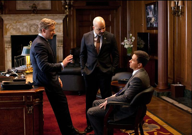 """This film image released by 20th Century Fox shows Russell Crowe, left, Jeffrey Wright and Mark Wahlberg, right, in a scene from """"Broken City."""" (AP Photo/20th Century Fox, Alan Markfield)"""
