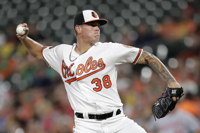 Baltimore Orioles starting pitcher Aaron Brooks throws to a Washington Nationals batter during the first inning of a baseball game, Wednesday, July 17, 2019, in Baltimore. (AP Photo/Julio Cortez)