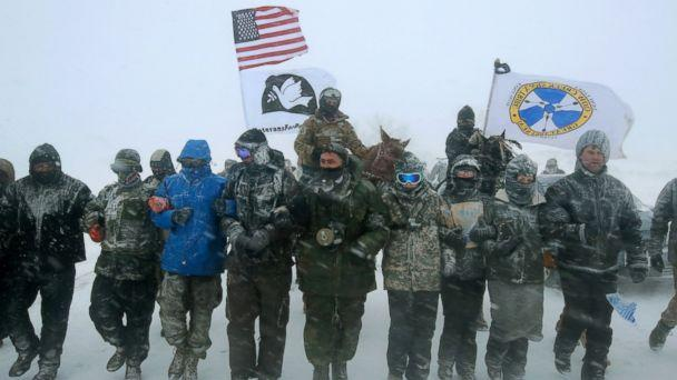 PHOTO: Despite blizzard conditions, military veterans march in support of the 'water protectors' at Oceti Sakowin Camp on the edge of the Standing Rock Sioux Reservation, Dec. 5, 2016, outside Cannon Ball, North Dakota. (Scott Olson/Getty Images)