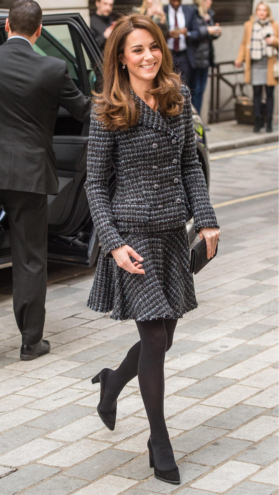 For a 'Mental Health In Education' conference in London, the Duchess of Cambridge braved the cold in a super chic tweed co-ord. To finish the look, she chose a Mulberry clutch and co-ordinating Tod's shoes. [Photo: Getty]