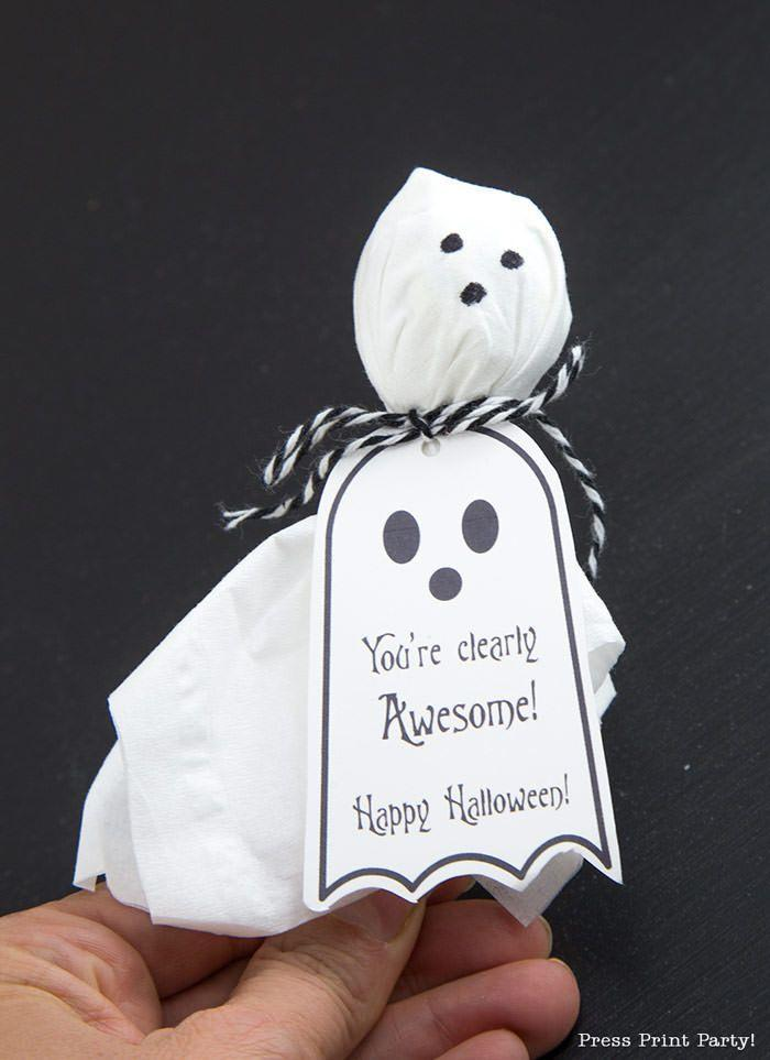"""<p>You can easily make crowd-pleasing ghost lollipops with tissues, baker's twine, and a marker. These sweet printable tags pull the look together and make them perfectly cute holiday giveaways.</p><p><em><a href=""""https://www.pressprintparty.com/free-printables/ghost-lollipops-free-printable-halloween-tags/"""" rel=""""nofollow noopener"""" target=""""_blank"""" data-ylk=""""slk:Get the printable at Press Print Party »"""" class=""""link rapid-noclick-resp"""">Get the printable at Press Print Party »</a></em></p>"""