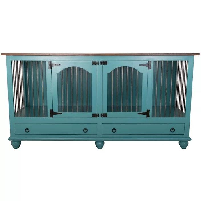"""If you have a large dog and a smaller home, space is already at a premium for you. Why not get a large dog crate that doubles as furniture? We love that this <a href=""""https://www.architecturaldigest.com/gallery/burrow-new-collection?mbid=synd_yahoo_rss"""" rel=""""nofollow noopener"""" target=""""_blank"""" data-ylk=""""slk:credenza"""" class=""""link rapid-noclick-resp"""">credenza</a> is big enough for beefy breeds and is functional enough that it could serve as a TV console, bar cart, or a place to display your favorite decor pieces. The two rolling drawers also help keep dog gear handy, but out of sight. $1942, Wayfair. <a href=""""https://www.wayfair.com/pet/pdp/tucker-murphy-pet-stelly-large-double-wide-credenza-pet-crate-w002695853.html"""" rel=""""nofollow noopener"""" target=""""_blank"""" data-ylk=""""slk:Get it now!"""" class=""""link rapid-noclick-resp"""">Get it now!</a>"""